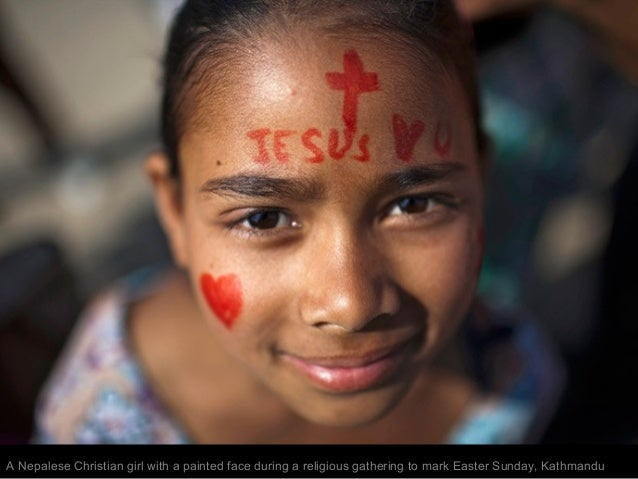 A Nepalese Christian girl with a painted face during a religious gathering to mark Easter Sunday, Kathmandu