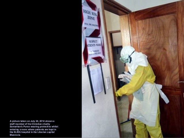 A picture taken on June 28, 2014 shows members of Doctors Without Borders (MSF) putting on protective gear at the isolatio...