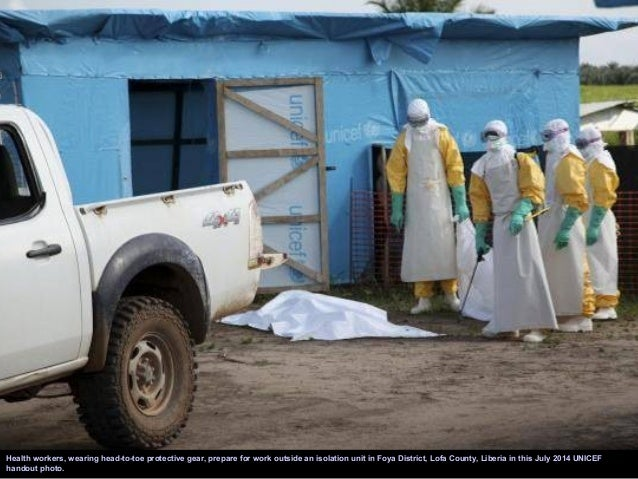 Medical staff working with Medecins sans Frontieres (MSF) put on their protective gear before entering an isolation area a...