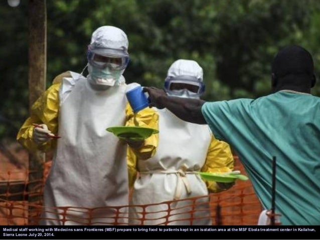 A health worker removes his protective suit as he emerges from an isolation area at the Medecins sans Frontieres Ebola tre...