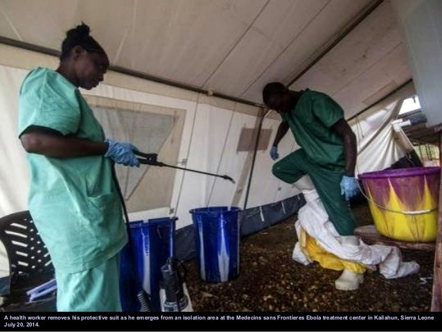 Government health workers are seen during the administration of blood tests for the Ebola virus in Kenema, Sierra Leone Ju...