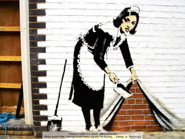 """12""""Sweep it under the carpet"""", Banksy, Hoxton Photo szater https://commons.wikimedia.org/wiki/File:Banksy_-_Sweep_at_Hoxto..."""