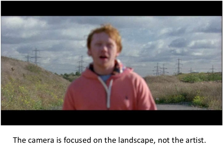 The Camera Is Focused On The Landscape, Not The Artist.