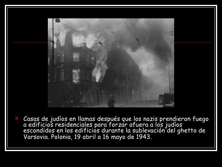 <ul><li>Casas de judíos en llamas después que los nazis prendieron fuego a edificios residenciales para forzar afuera a lo...