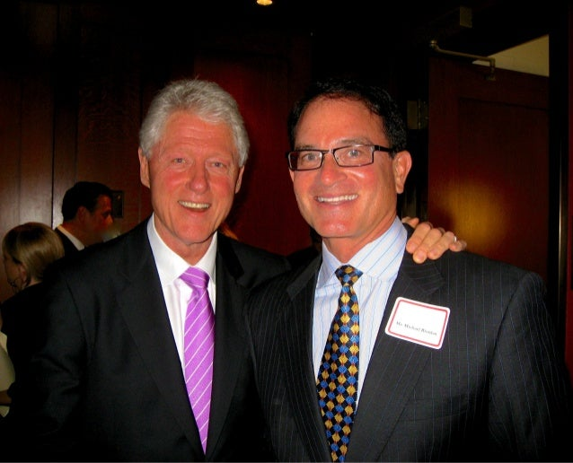 Photo of Gilead Founder Michael L. Riordan and President Bill Clinton