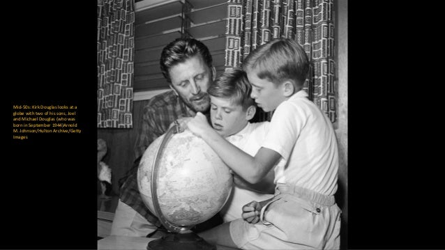 circa 1955: Kirk Douglas and his wife Anne show off their newborn son PeterKeystone/Getty Images