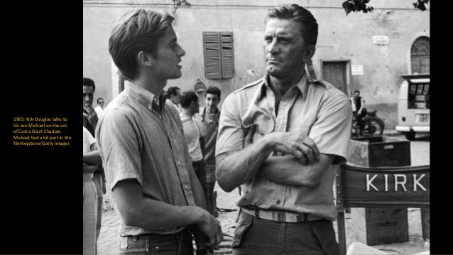 26 March 1965: Kirk Douglas and Richard Harris chat during the making of Heroes of Telemark, a film about the Norwegian re...