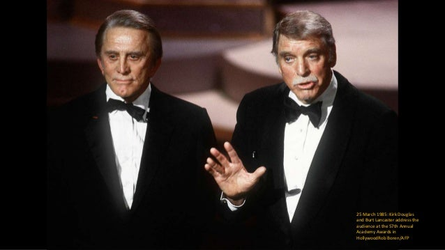 25 March 1996: Kirk Douglas salutes the crowd at the 68th Annual Academy Awards after he received an Oscar for lifetime ac...