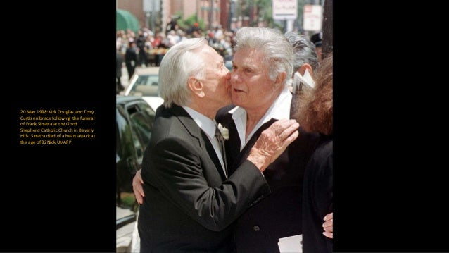 3 March 2001: Catherine Zeta-Jones kisses her father-in-law Kirk Douglas, after she presented him with the Milestone Award...