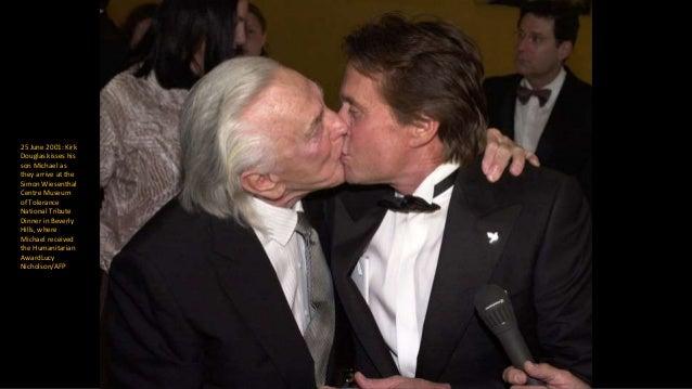 September 2007: Alec Baldwin kisses the hand of Kirk Douglas as Catherine Zeta-Jones and her husband Michael Douglas look ...