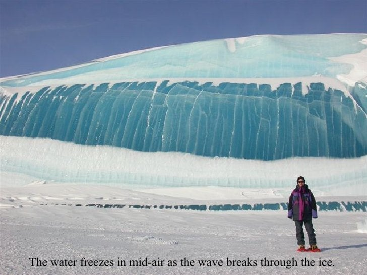 The water freezes in mid-air as the wave breaks through the ice.