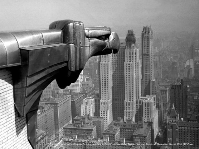 A gargoyle atop the Chrysler Building watches vigilantly over the rising Gotham towers of midtown Manhattan, May 6, 1931. ...