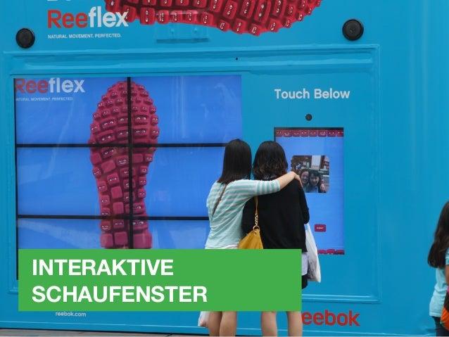 INTERAKTIVE SCHAUFENSTER Bei einem interaktiven Schaufenster wird an der Innenseite der Schaufensterscheibe eine Touch-Fol...