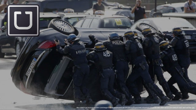 http://static4.uk.businessinsider.com/image/558bf8c3848fb6491d61b4cd/stunning-pictures-of-paris-in-chaos-as-anti-uber-taxi...