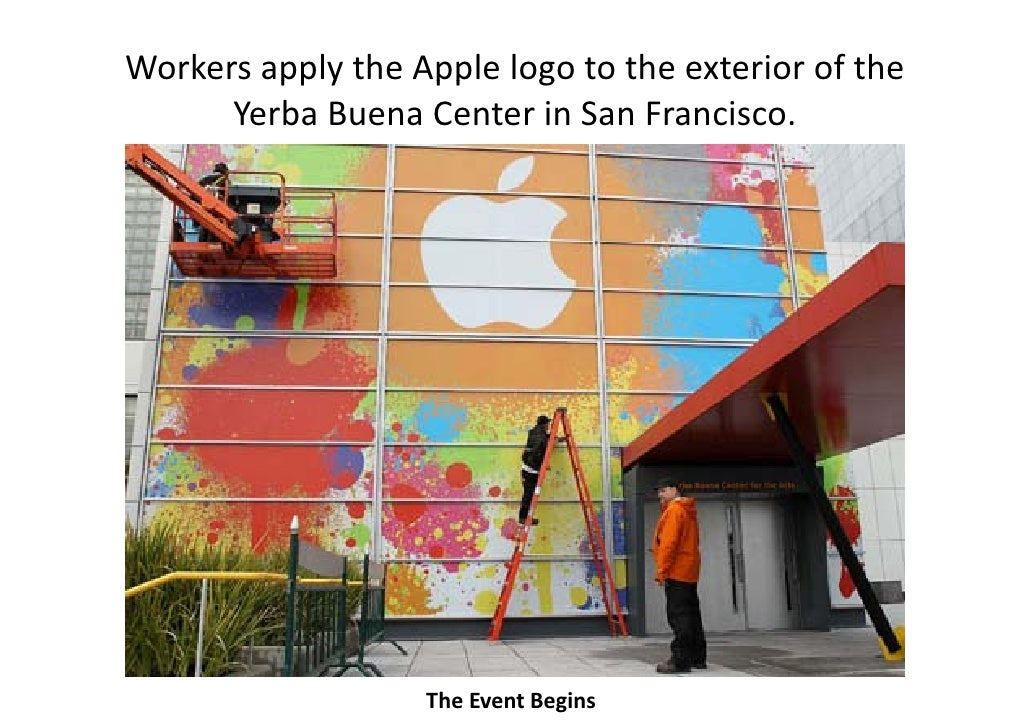 Workers apply the Apple logo to the exterior of the           pp y      pp     g       Yerba Buena Center in San Francisco...