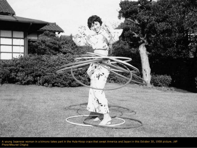 A young Japanese woman in a kimono takes part in the Hula-Hoop craze that swept America and Japan in this October 30, 1958...