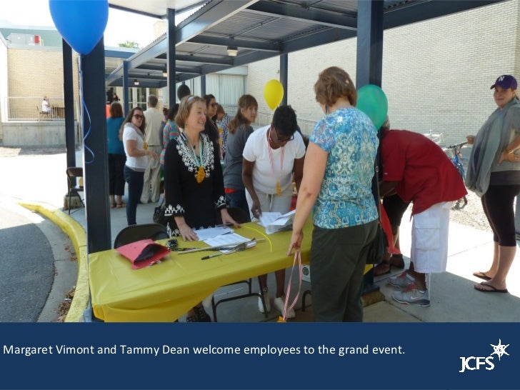 Margaret Vimont and Tammy Dean welcome employees to the grand event.