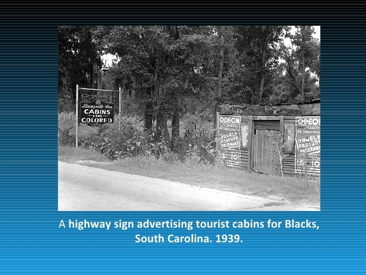 A highway sign advertising tourist cabins for Blacks,              South Carolina. 1939.