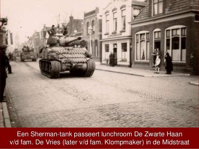 Een Sherman-tank passeert lunchroom De Zwarte Haan v/d fam. De Vries (later v/d fam. Klompmaker) in de Midstraat
