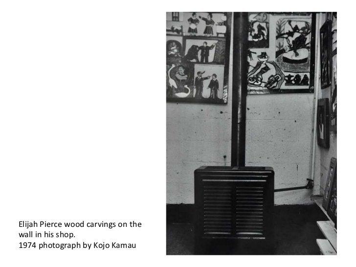 Elijah Pierce wood carvings on thewall in his shop.1974 photograph by Kojo Kamau