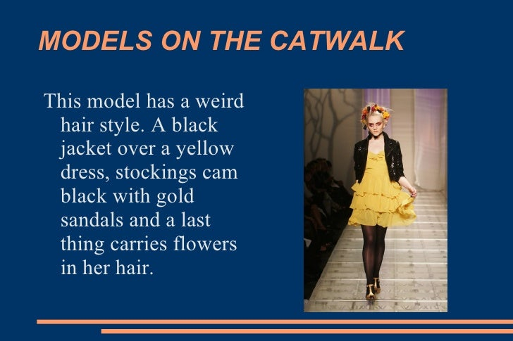 MODELS ON THE CATWALK This model has a weird hair style. A black jacket over a yellow dress, stockings cam black with gold...