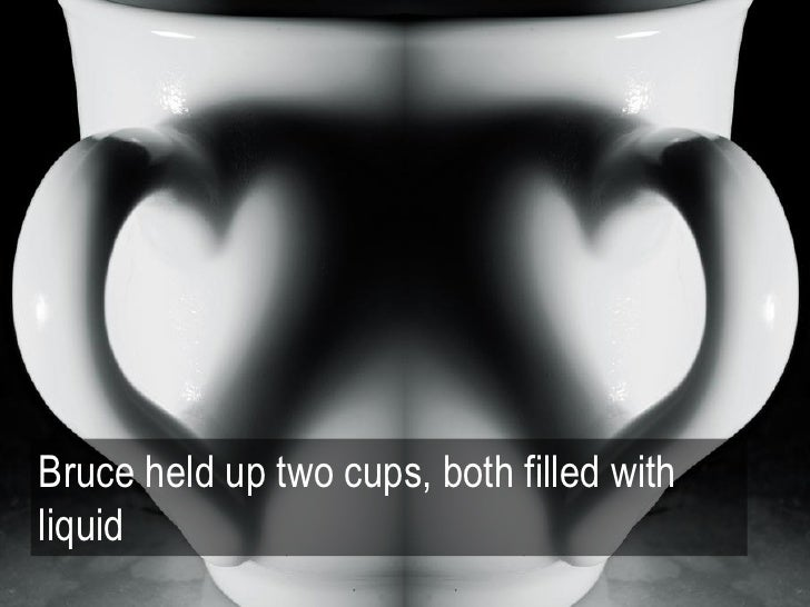 Bruce held up two cups, both filled withliquid                                           by :: Robee ::, flickr