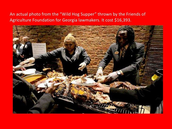 """An actual photo from the """"Wild Hog Supper"""" thrown by the Friends ofAgriculture Foundation for Georgia lawmakers. It cost $..."""