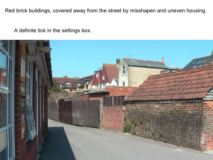 Red brick buildings, covered away from the street by misshapen and uneven housing. A definite tick in the settings box.