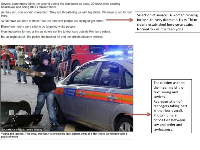Person in the picture labelled as a 'rioter' though no evidence to suggest he is doing anything wrong other than walking p...