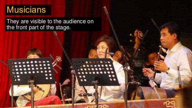 They are visible to the audience on the front part of the stage. Musicians