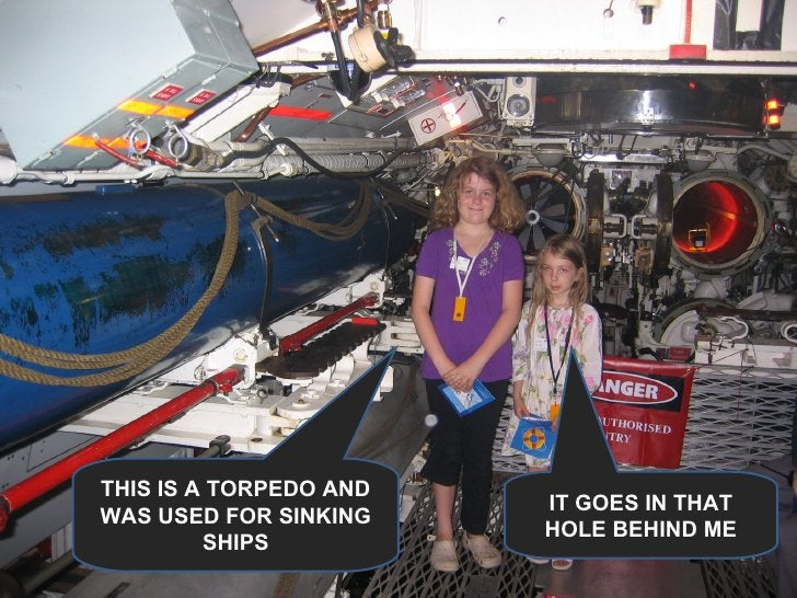 THIS IS A TORPEDO AND WAS USED FOR SINKING SHIPS IT GOES IN THAT HOLE BEHIND ME