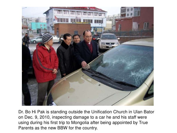 Dr. Bo Hi Pak isstanding outside the Unification Church in Ulan Bator on Dec. 9, 2010, inspecting damage to a car he and h...