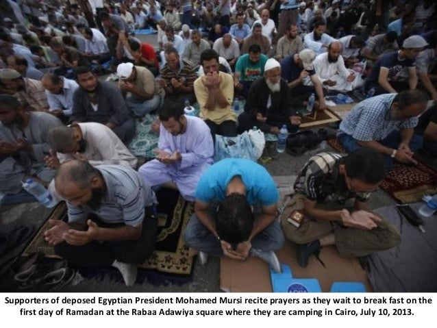 Supporters of deposed Egyptian President Mohamed Mursi recite prayers as they wait to break fast on the first day of Ramad...