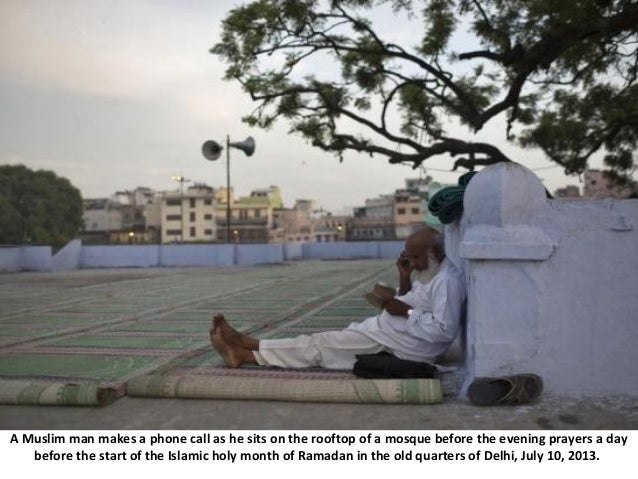 A Muslim man makes a phone call as he sits on the rooftop of a mosque before the evening prayers a day before the start of...