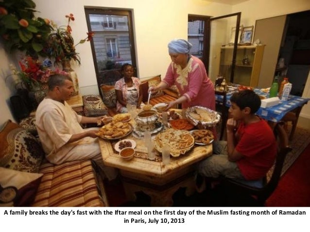 A family breaks the day's fast with the Iftar meal on the first day of the Muslim fasting month of Ramadan in Paris, July ...