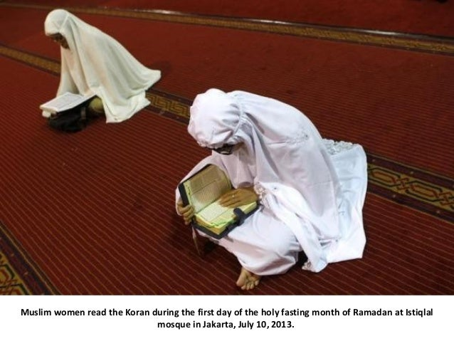 Muslim women read the Koran during the first day of the holy fasting month of Ramadan at Istiqlal mosque in Jakarta, July ...