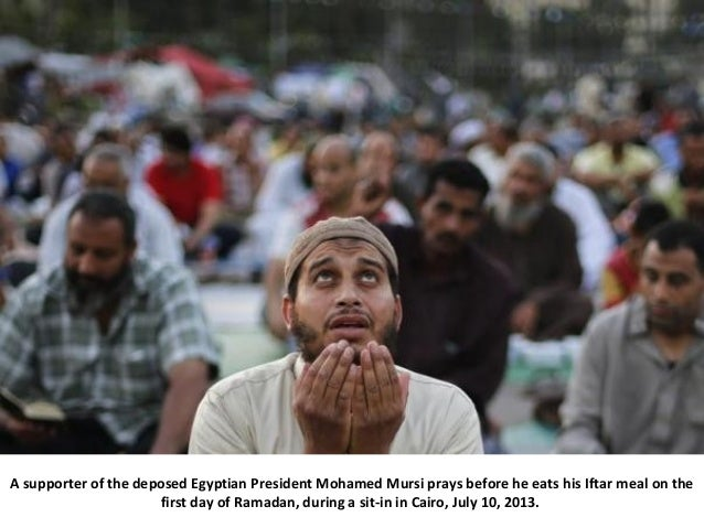 A supporter of the deposed Egyptian President Mohamed Mursi prays before he eats his Iftar meal on the first day of Ramada...