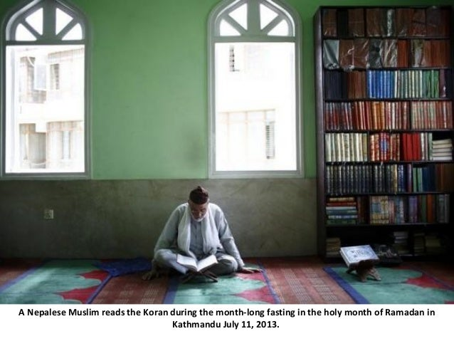 A Nepalese Muslim reads the Koran during the month-long fasting in the holy month of Ramadan in Kathmandu July 11, 2013.