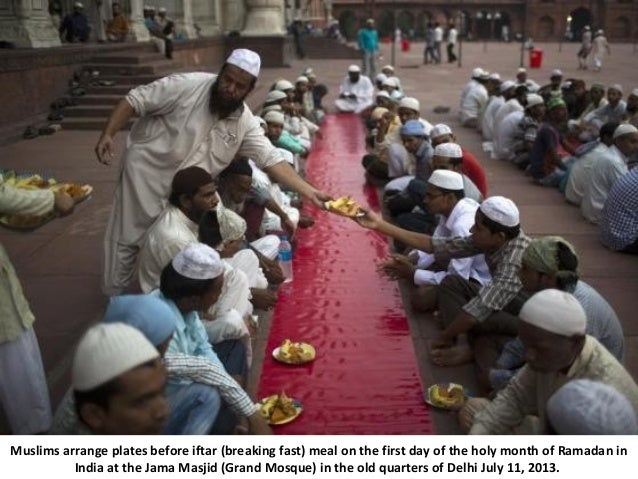 Muslims arrange plates before iftar (breaking fast) meal on the first day of the holy month of Ramadan in India at the Jam...