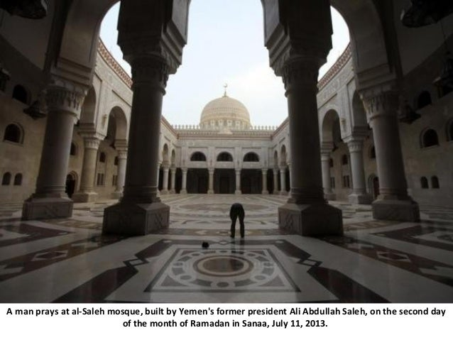 A man prays at al-Saleh mosque, built by Yemen's former president Ali Abdullah Saleh, on the second day of the month of Ra...