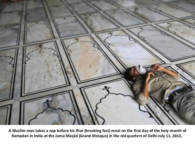 A Muslim man takes a nap before his iftar (breaking fast) meal on the first day of the holy month of Ramadan in India at t...