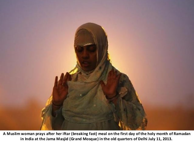 A Muslim woman prays after her iftar (breaking fast) meal on the first day of the holy month of Ramadan in India at the Ja...