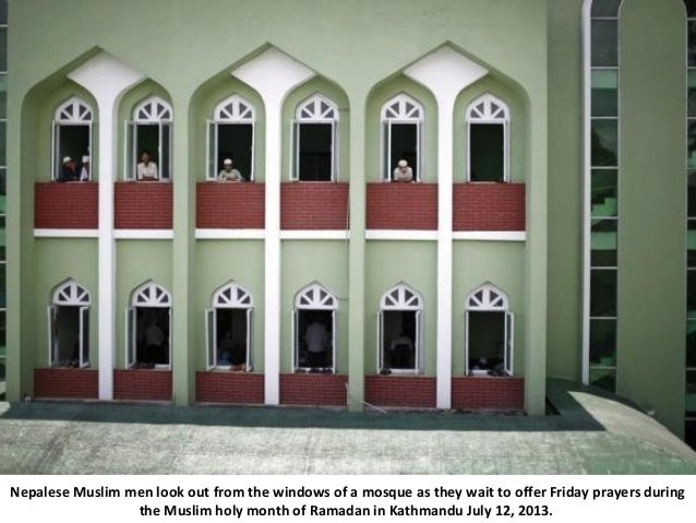 Nepalese Muslim men look out from the windows of a mosque as they wait to offer Friday prayers during the Muslim holy mont...