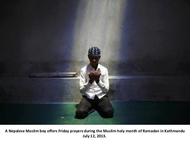 A Nepalese Muslim boy offers Friday prayers during the Muslim holy month of Ramadan in Kathmandu July 12, 2013.
