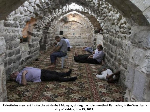 Palestinian men rest inside the al-Hanbali Mosque, during the holy month of Ramadan, in the West bank city of Nablus, July...