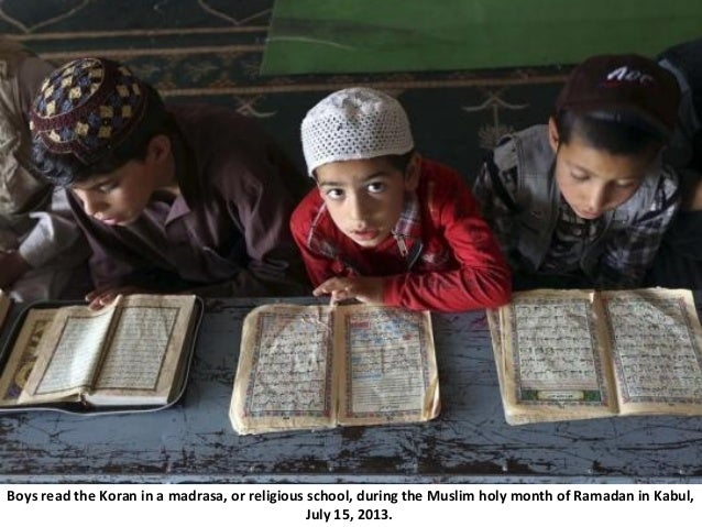Boys read the Koran in a madrasa, or religious school, during the Muslim holy month of Ramadan in Kabul, July 15, 2013.