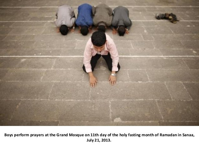 Boys perform prayers at the Grand Mosque on 11th day of the holy fasting month of Ramadan in Sanaa, July 21, 2013.