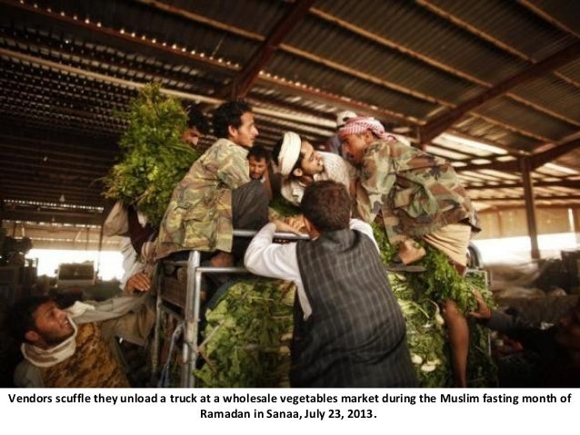 Vendors scuffle they unload a truck at a wholesale vegetables market during the Muslim fasting month of Ramadan in Sanaa, ...