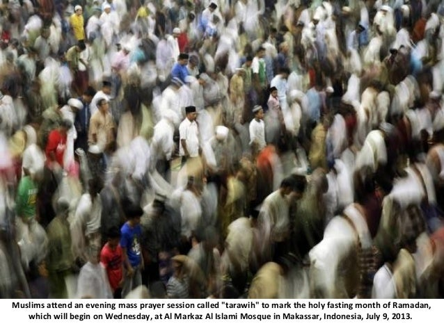 """Muslims attend an evening mass prayer session called """"tarawih"""" to mark the holy fasting month of Ramadan, which will begin..."""