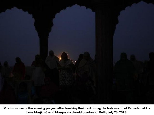 Muslim women offer evening prayers after breaking their fast during the holy month of Ramadan at the Jama Masjid (Grand Mo...